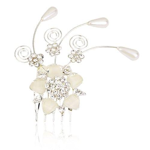 acheter maintenant     EUR 3,75 Description:   Matériel: Alliage, perles artificielles, strass  Couleur: Argent + blanc crèmeTaille (L x P): Env. 8 x 8cm  Paquet comprend:   1 x peigne Matériel: Alliage, perles artificielles, strassCouleur: Argent +…