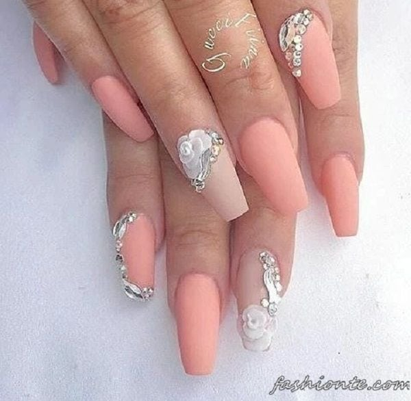 Very fresh looking summer nail art design. The melon coated nails simply look amazing while there are beautiful silver embellishments and beads added on top to complete the wonderful effect. Source by stacie805   …