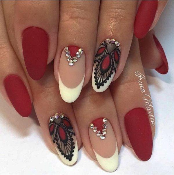 White and maroon nail art design. A wonderful combination of french tips as well as lace designs that's combining the white, black and maroon nail polish making the overall design look more elegant. Source by nenuno   …