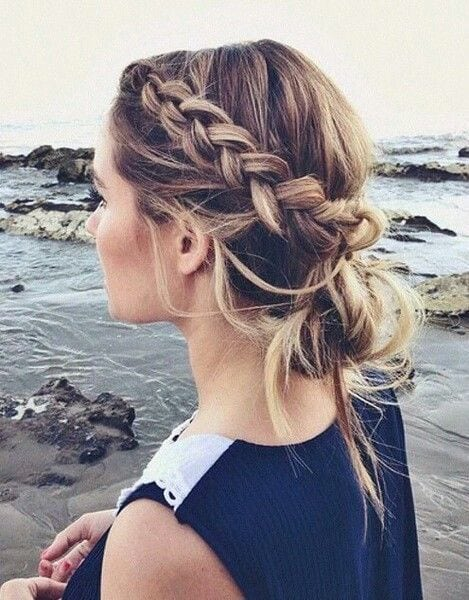 dutch accent braid into a messy low bun for a cute casual hairstyle on brunette hair with blonde highlights See more cute hairstyles here: www.amodernmomblo… Source by amodernmomblog   …