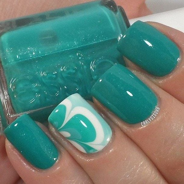 """[ad_1]  If you use the terminology of the fashion industry, turquoise became """"the new black"""" in the nail-art of the year 2015. Almost all the leading manufacturers of paints included collection of variations on turquoise: bright, pastel, Matt, glossy, with a…"""