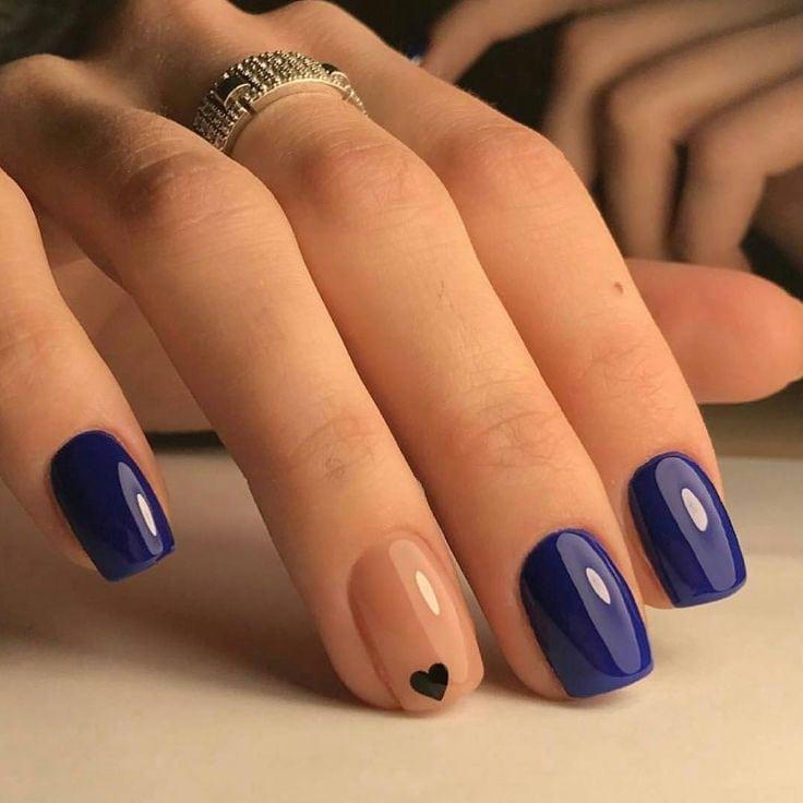 Beautiful Navy Blue nails with tiny Heart shape. pink nail polish on rounded shaped nail. noahxnw.tumblr.co… Source by jadexandra5   …