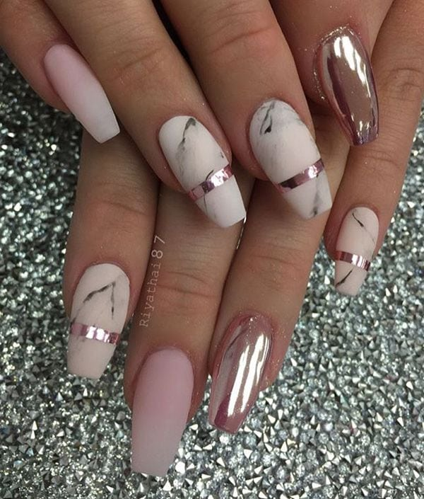 Here is a combination of matte color in marble design with glossy paint on one nail. So fine that you can see yourself in it. Source by lmcgrathxoxo   …