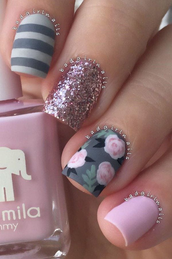 Here we see what I mention in previous image. Grey color is combined with pink roses and green details. One nail is in very light pink shade. There's also a little bit of black color, and beautifully golden sparkle on…