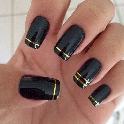 22 Black Nails That Look Edgy and Chic – Elegant gold striped nails. Source by janssen2691   …