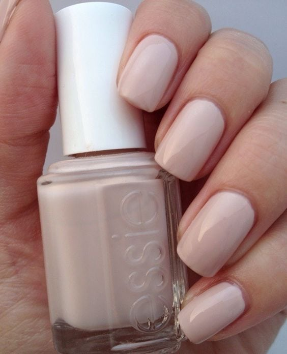 "Most popular nail polish on Pinterest is the perfect nude —Essie, ""Topless & Barefoot"". It's flattering on all skin tone sand has a hint of pink!