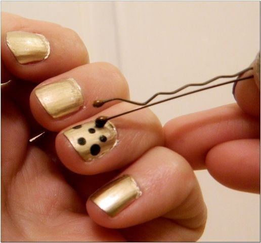 Using a bobby pin to make dots on your nails