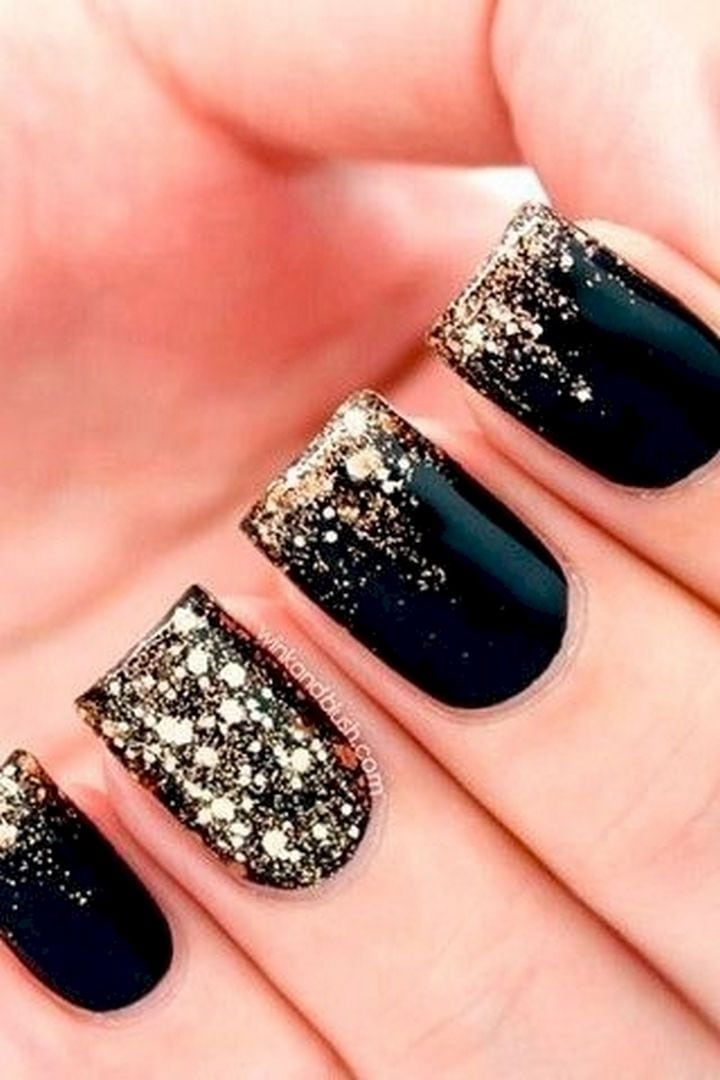22 Black Nails That Look Edgy and Chic – Glossy black with a gold glitter fade.
