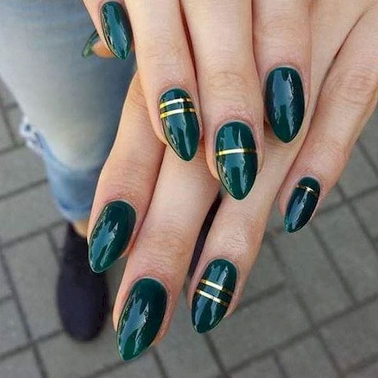 18 Green Manicures – Add some flair with gold striping tape.