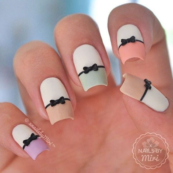 Cute pastel colored bow French tips. Give a new look to your French tips by adding thing bow embellishments on top. Source by znoll   …