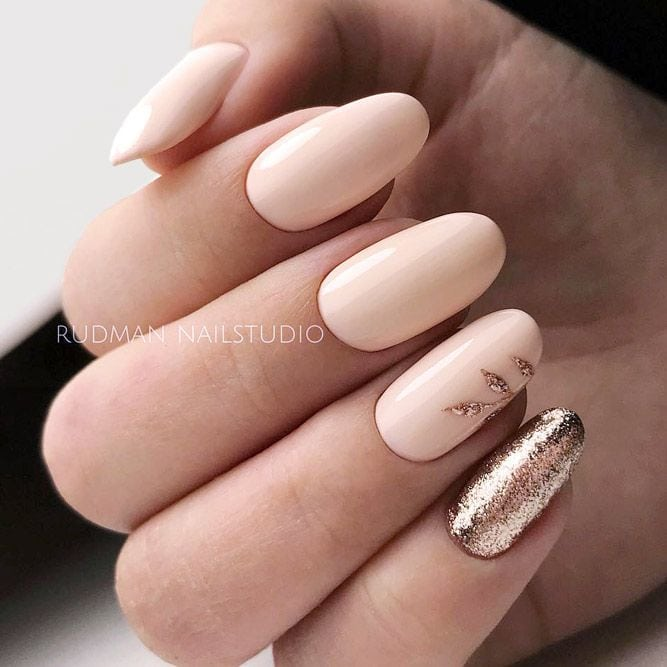 Peach Shellac Nails With Rose Gold Glitter Accents #peachnails #glitterails #ovalnails ★ Have you tried shellac nails already? Discover plenty of pretty designs for shellac manicure here. ★ See more: glaminati.com/… #glaminati #lifestyle #nails #nailart #naildesigns #shellacnails