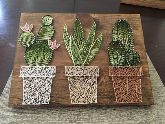 Welcome to my shop! Im a mother of two taking advantage of nap-time by creating amazing conversational piece string art. Each piece is cut, sanded, stained by me, customized by you and enjoyed by all. Cactus Garden This piece is…