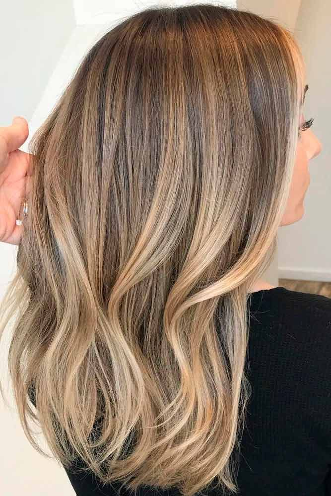 Light and dark brown hair with highlights and lowlights looks spectacular. Discover trendy color ideas for short and long hairstyles. #glaminati #lifestyle #hairstyles #highlights