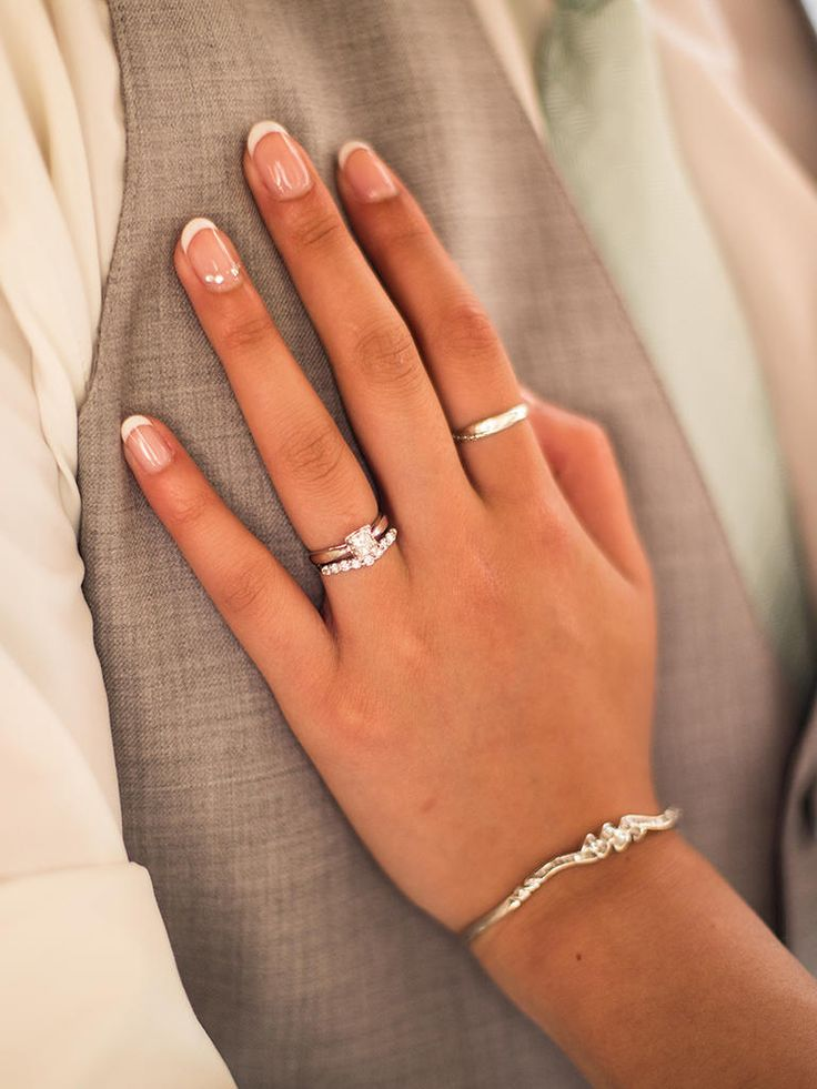 Highlight your engagement ring with a  French manicure and accented ring finger nail. Source by theknot   …